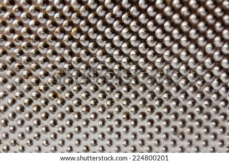 Steel surface with beads, surface of grater closeup