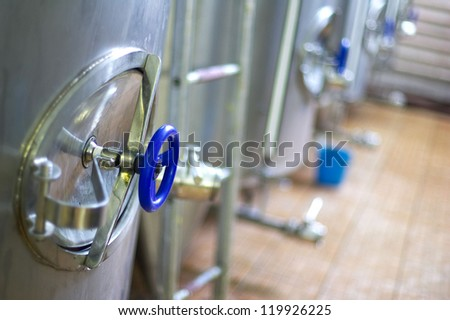Steel tanks in a brewery - stock photo