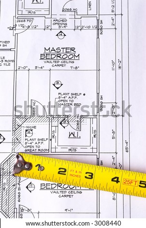 Steel Tape Measure on House Blueprints - stock photo