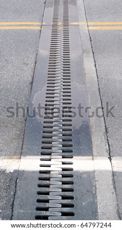 Steel teeth expansion joint on bridge - stock photo