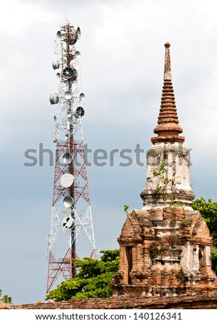 Steel telecommunication tower with old pagoda - stock photo