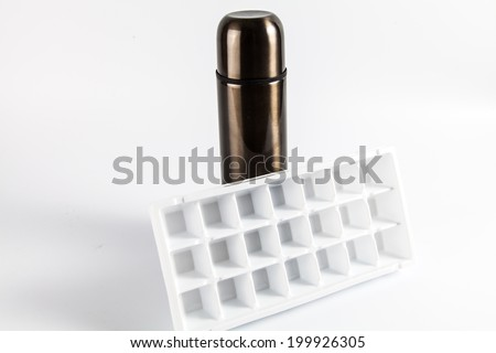 Steel thermos with Ice cube tray isolate on white background - stock photo