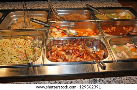 steel tray filled with food inside the self service Chinese restaurant - stock photo