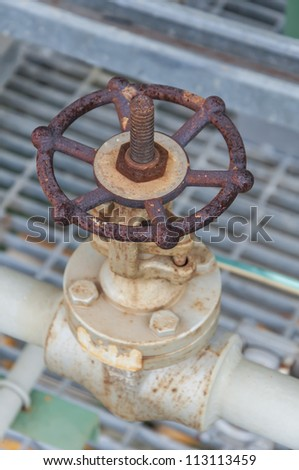 Steel valve in chemical industrial plant - stock photo