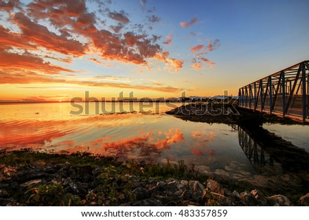 steel walking bridge by the sea at sunset time, Tsawwassen, , Delta, British Columbia, Canada