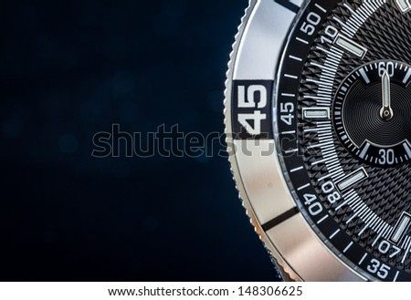 Steel watch detail, concept for time. Selective focus, shallow depth of field. - stock photo