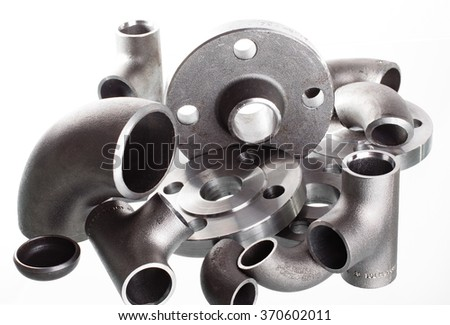 Steel welding fittings on group. Flanges, elbow, tees and plug on white space. - stock photo