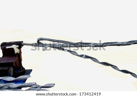 Steel wire for straining electrical cable - stock photo