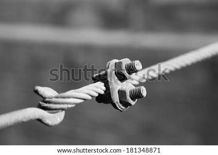 steel wire rope full of greasy dirt and connection fasteners