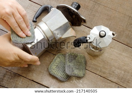 steel wool soap cleaning espresso coffee maker - stock photo