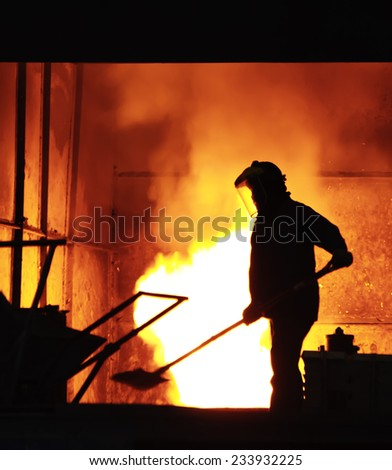 steel worker takes a sample from oven - stock photo
