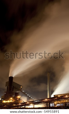 steel works at dusk - stock photo