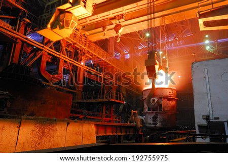 steel works, crane with stove busket - stock photo