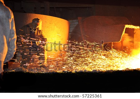 Steelmaker Burns Oxygen Opening for Producing of Cast-!ron from a High Furnace. Iron and Steel Metallurgical Plant.
