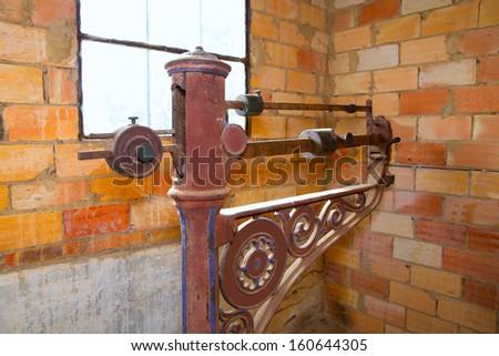 steelyard roman balance romaine grunge antique in a brickwall - stock photo