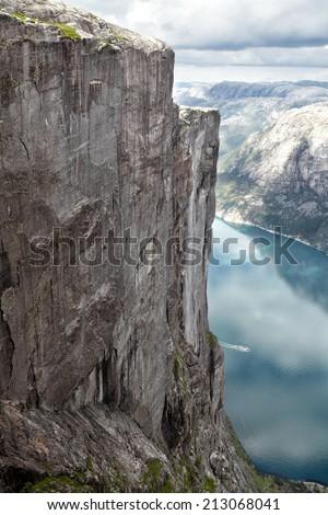 Steep cliff at Kjeragbolten, Kjerag in Norway - stock photo