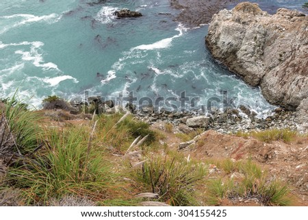Steep cliffs, rock and geological formations along the rugged Big Sur coastline, near Monterey, CA. on the California Central Coast. - stock photo