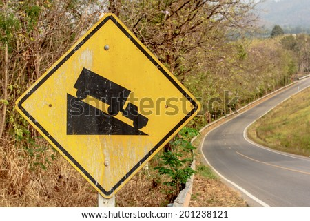 Steep grade hill ahead warning road sign - stock photo