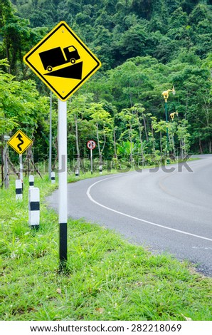 Steep grade hill traffic sign on road into the mountain. - stock photo