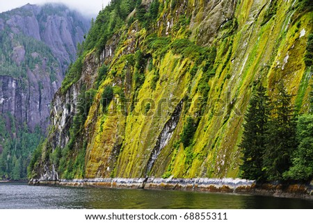 Steep mountain cliffs of the Misty Fjords near Ketchikan, Alaska - stock photo
