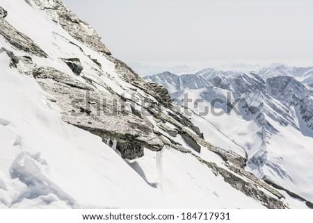 Steep mountain slope with frozen rocks, Ankogel, Austria - stock photo