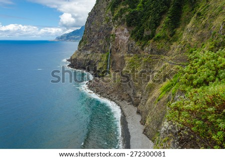 Steep northern shore of the island of Madeira, a waterfall. Madeira island, Portugal. - stock photo