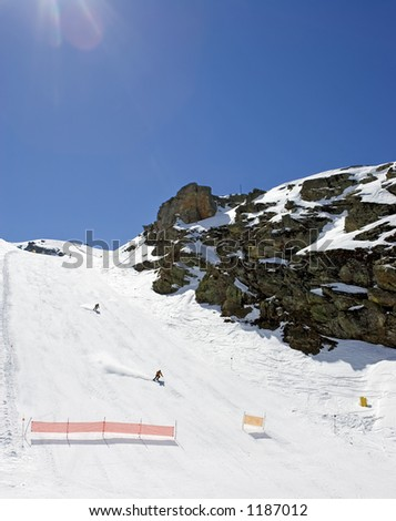 Steep snowy ski slopes of Pradollano ski resort in the Sierra Nevada mountains in Spain with people skiing - stock photo