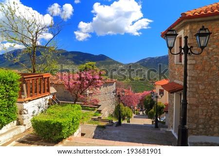 Steep street in the mountain town of Arachova, Greece - stock photo
