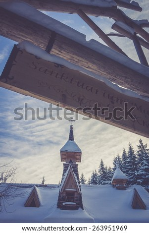 steeple in snow - stock photo