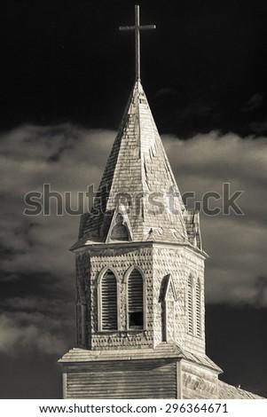 Steeple of the Roman Catholic Church in Fish Creek, Saskatchewan - stock photo