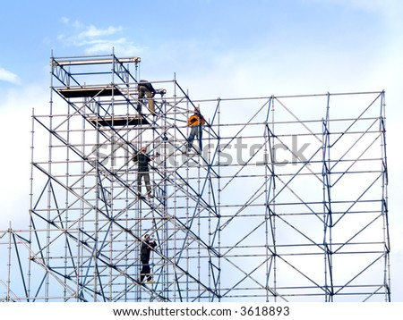 Steeplejacks on a scaffold in the sky