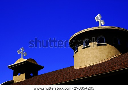 Steeples of Church crosses with blue sky and clouds in background - stock photo