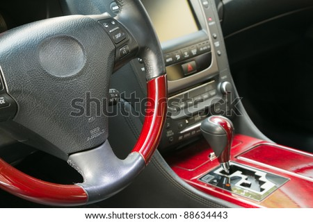 Steering wheel and gear shift stick of in luxury car - stock photo