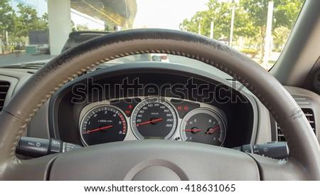 Steering wheel and indicator gauge - stock photo