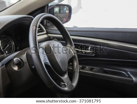 Steering wheel and interior view of car. - stock photo