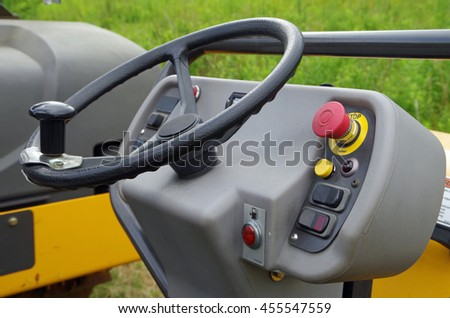 Steering wheel and start up switches of asphalt roller equipment