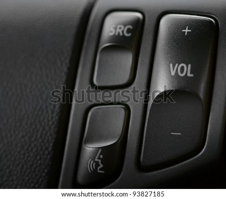 Steering wheel detail, car sound control close up - stock photo