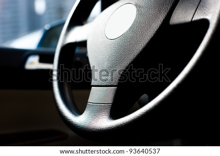 Steering wheel in interior of a new car. - stock photo
