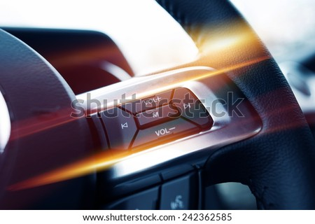 Steering Wheel Music Control. Car Stereo Steering Wheel Control Buttons Closeup. - stock photo