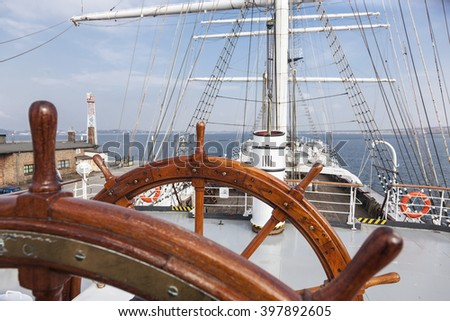 steering wheel of an old sailing ship - stock photo