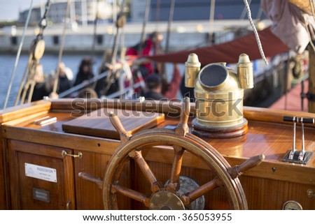 Steering wheel of an old wooden sailing ship - stock photo