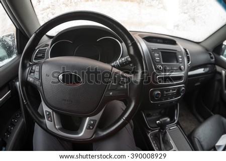 Steering wheel of vehicle, car interior, fisheye view - stock photo