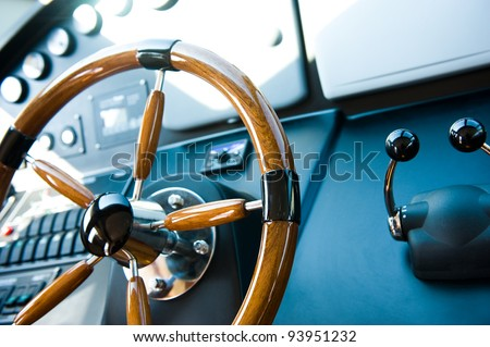 steering wheel on a luxury yacht. - stock photo