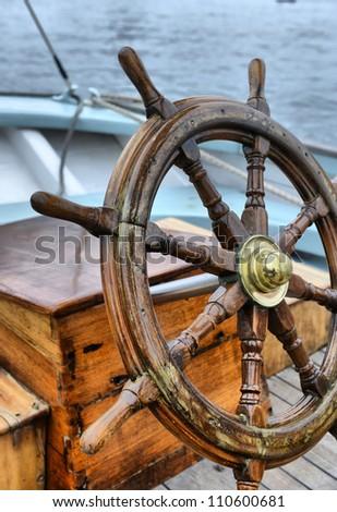 steering wheel sailboat - stock photo