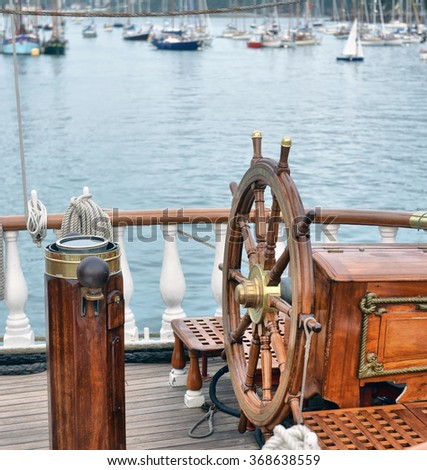 steering wheel sailboat - stock photo
