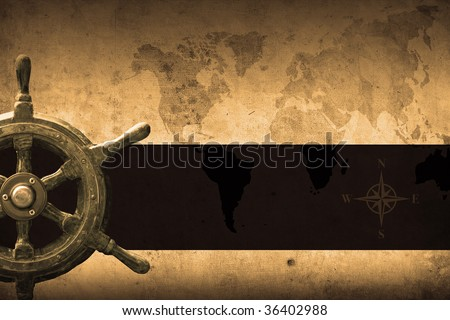 steering wheel with a navigator and lighthouse - stock photo