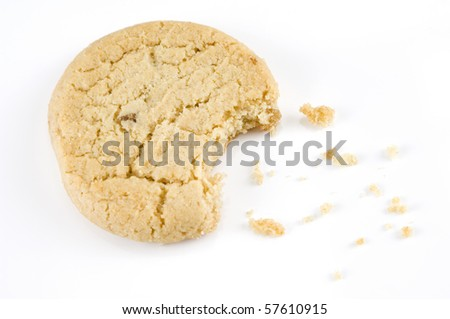 Stem ginger cookie with a bite out of it on a white background - stock photo