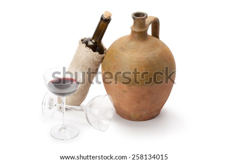 stemware, bottle of wine and old amphora isolated on white background - stock photo
