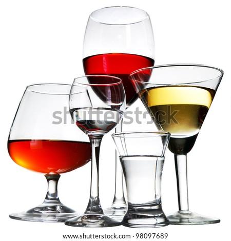 stemware with vodka, red wine, on white background - stock photo