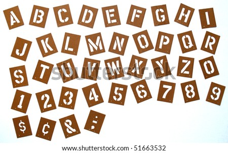 Stencils of the alphabet, numbers, and symbols. - stock photo